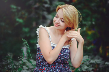 portrait of a happy woman on a picnic braided hair and smiling, togetherness with nature and a healthy lifestyle