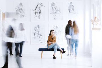 Tourist woman visiting art gallery