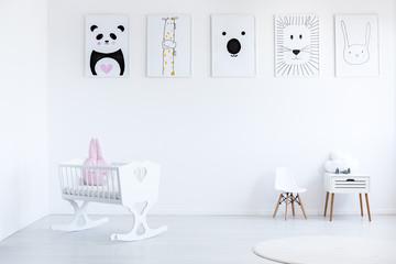 White cradle in baby's bedroom