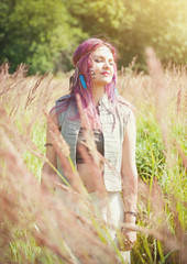 Beautiful woman in boho style enjoy sunlight