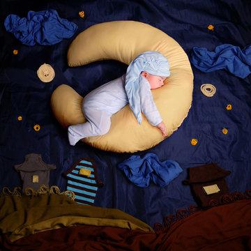 Studio portrait of infant baby boy wearing a stocking cap