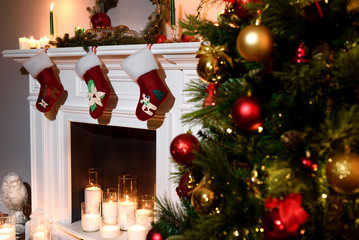 Papiers peints Comics A beautiful new year attributes: a decorated tree and a warm fireplace with present toys. Decorated bright red Christmas socks hanging on a fireplace waiting for presents. New year design.