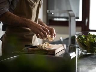 Man cooking salad
