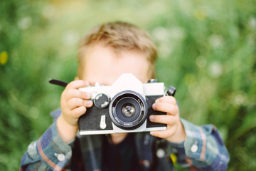 Child with an analog camera