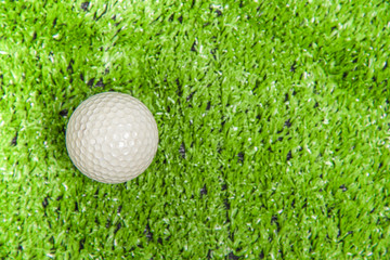 Golf ball on the green lawn or green grass