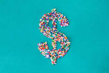 The dollar symbol built from nonpareils