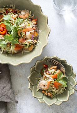 Thai mango salad with fresh shrimps and cashew nuts