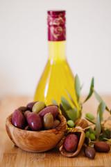 olives on wooden background, kalamata, kalamon, green olives