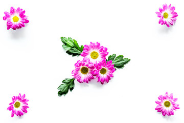 Floral pattern with pink flowers and green leaves on white background top view copyspace