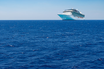 Cruise transportation background. Luxury passenger cruise ship on the Mediterranean Sea.