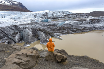 Woman enjoying view of glacier landsape in Iceland