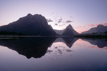 reflection of Milford sound fjord at sunset