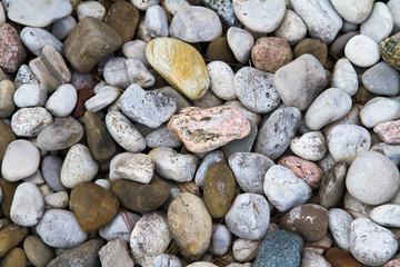 Smooth stones lining a rock garden