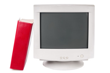 Antique computer monitor and textbook on white background