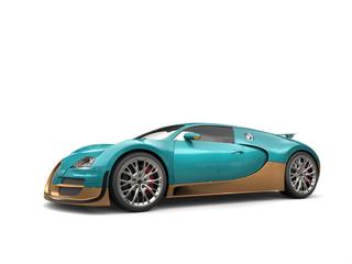 Metallic dark cyan modern super sports car with golden details - studio shot