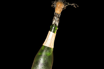 shot of a champagne cork on a black background