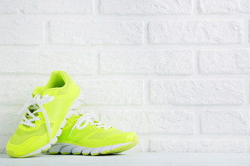 Pair of sport shoes on a brick wall background