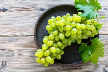 Bunch of ripe white grapes.