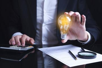 businessman hand idea or light bulb and document