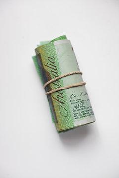 Rolls of Australian 100 dollar bills on white background