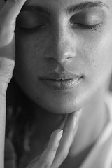 Portrait of a beautiful woman with freckles