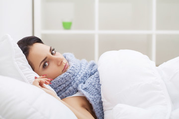 Cold And Flu. Woman sleep and hold her head with subliminal stress or other possible symptoms
