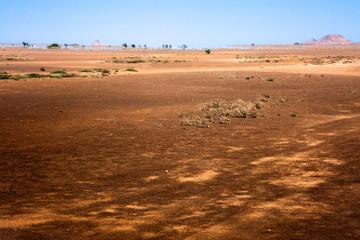 Desert fields in North Sal Island, Cape Verde. Mirage at horizon