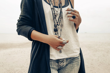 close up of boho style woman with stylish accessories and jewellery