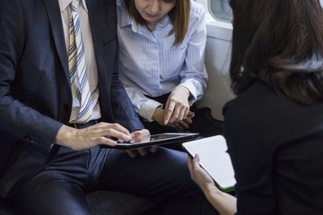 Colleagues meeting with a tablet while on a business trip