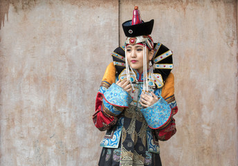 mongolian woman in traditional 13th century style outfit