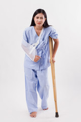 unlucky woman patient with broken arm and leg