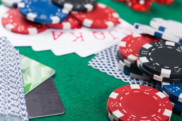 winning combinations of cards on a green poker table, bank cards to pay for victory