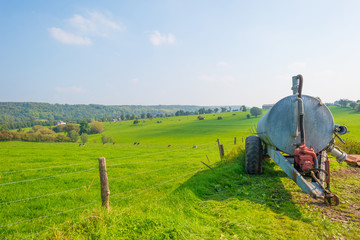 Stock tank in a meadow in sunlight in autumn
