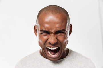 Emotional screaming young african man