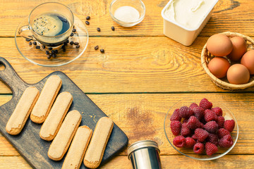 Image on top of ingredients for tiramisu with raspberries