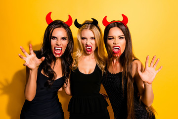 Nightmare, hunger, thirst, death, will to kill and drink. Elegant, mystical gorgeous satanic zombies in fashionable dark dresses, shows cuspids and arm palm with claws, bonding isolated background