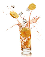 glass full of orange drink with orange slices and ice cubes falling and splashing, on white background