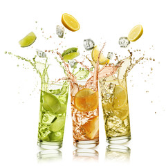 Fototapete - citrus fruits soft drink with fruit slices and ice cubes falling and splashing, on white background