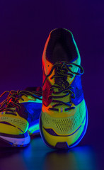 sports footwear on a black background a