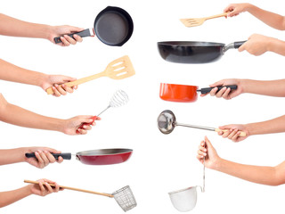 Chef's hands holding kitchen utensils/many equipments for food isolated on white background