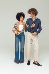 Emotional retro loving couple standing and posing