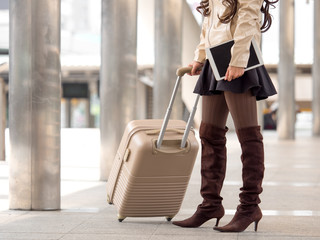 Woman traveler holding bag, luggage, suitcase in the airport during traveling,.travel, trip for woman concept