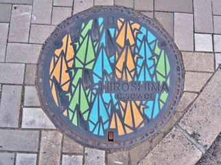 Manhole cover of Hiroshima engraved with origami paper cranes. The one thousand origami cranes were through the story of Sadako Sasaki, victims of nuclear warfare.