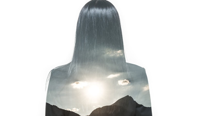 Inner world. Double exposure. Woman in business suit with long hair from back. Landscape of the mountain and sunset.