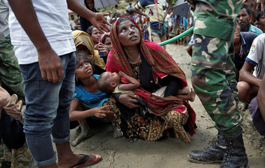 Rohingya refugees wait to receive aid in Cox's Bazar, Bangladesh