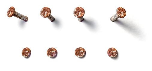 Freigestellter rostiger Nagel aus unterschiedlichen Perspektiven