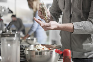 Close-up of man preparing meal in kitchen