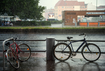bicycle on wet street in Berlin city in rain