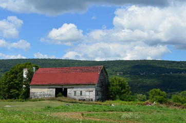 Beautiful old weathered barn on an upstate New York hillside in summer