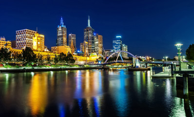 A beautiful view of Melbourne downtown across the Yarra river at night in Melbourne, Victoria, Australia.